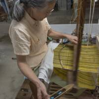 A stitch in time: A weaver at Kiyoka Bashofu,  works tirelessly on a piece of precious fabric. | STEPHEN MANSFIELD