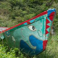 A traditional sabani fishing boat with its lucky eye in Ogimi-so, Okinawa. | STEPHEN MANSFIELD