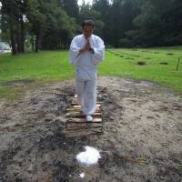 Dangerous footwork: A yamabushi mountain ascetic demonstrates fire walking on a course with ceremonial salt at each end. | KATHRYN WORTLEY