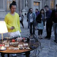 "Audio snapshots: Aki Onda gives a ""Cassette Memories"" Performance in front of the Louvre in Paris in May 2011. 