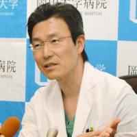 Transplant issues: Dr. Takahiro Oto talks to the press after performing a lung-transplant operation at Okayama University Hospital. Although Oto is in demand as a leading lung-transplant surgeon, he is required to spend time on not only screening donors, but also providing aftercare to patients. | KYODO