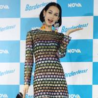 Kiko Mizuhara received abuse on Twitter following her participation in a series of promotional posts by Suntory's Premium Malts account. | KYODO
