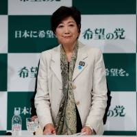 Disruptive influence: Tokyo Gov. Yuriko Koike, head of Kibo no To (Party of Hope), holds a news conference in Tokyo on Oct.  6. | REUTERS