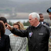 U.S. Vice President Mike Pence inspects the Korean Demilitarized Zone on April 17. Such front-line visits are viewed as reaffirming the U.S.-South Korean defense pact. | BLOOMBERG