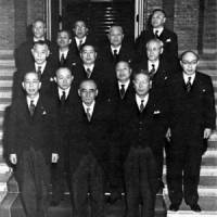Tanzan Ishibashi  poses with members of his Cabinet in 1957. Nobusuke Kishi is on his left.