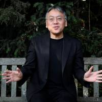 Nobel winner: Author Kazuo Ishiguro poses for the media outside his home in London on Oct. 5, following the announcement that he has won the Nobel Prize in literature. | REUTERS