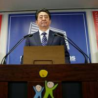 Prime Minister Shinzo Abe attends a news conference at LDP headquarters in Tokyo on Monday following his ruling coalition's victory in Sunday's Lower House election. Abe will meet with U.S. President Donald Trump in the first week of November. | REUTERS
