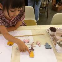 A blissful moment of peace as kids at a Small is More workshop create a Halloween-inspired mobile. | DANIELLE DEMETRIOU
