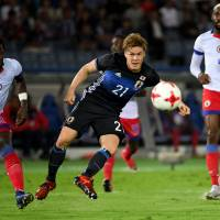 Shinji Kagawa's injury-time goal gives Japan draw with Haiti