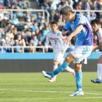 Kazuyoshi Miura scores for Yokohama FC against Thespakusatsu Gunma on March 12, becoming the world's oldest goalscorer in a competitive game ever. | KYODO