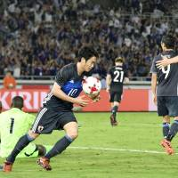 Japan's Shinji Kagawa celebrates his game-tying goal in the 92nd minute on Tuesday. | KYODO