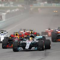 Lewis Hamilton heads to Japan wary of challengers