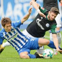 Hertha Berlin's Genki Haraguchi (left) will miss two matches after receiving a red card last weekend against Schalke. | KYODO