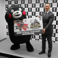 Popular mascot Kumamon and B. League chairman Masaaki Okawa are seen at a news conference on Tuesday in Tokyo to promote the 2018 All-Star Game in Kumamoto. | KYODO