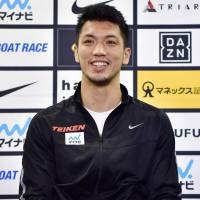 WBA middleweight champion Ryota Murata smiles at a news conference in Tokyo on Monday. | KYODO
