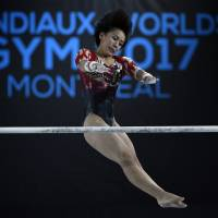 Mai Murakami competes on the uneven bars during the World Artistic Gymnastics Championships in Montreal on Friday. | USA TODAY / VIA REUTERS