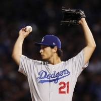 Dodgers pitcher Yu Darvish stretches during Game 3 of the NLCS on Oct. 17 in Chicago. | USA TODAY / VIA REUTERS