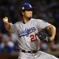 Dodgers starter Yu Darvish pitches against the Cubs during Game 3 of the National League Championship Series on Oct. 18 at Wrigley Field in Chicago.   USA TODAY / VIA REUTERS