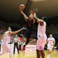 The Alvark's Daiki Tanaka leaps as he takes a shot in first-quarter action on Tuesday in Tokyo. | B. LEAGUE