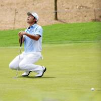 Hideki Matsuyama reacts after missing a birdie putt on the 17th hole at the CIMB Classic in Kuala Lumpur on Sunday. | KYODO