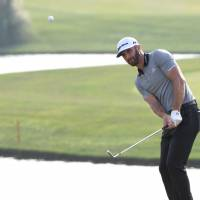 Successful strategy: Dustin Johnson swaps putters to grab Shanghai lead