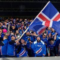 Iceland's fans celebrate  the team's 2-0 victory over Kosovo on Monday in Reykjavik. With the victory, Iceland became the smallest country to ever qualify for the World Cup.   AFP-JIJI