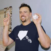 Orix's Chris Marrero holds up his home run ball after hitting the 100,000th homer in NPB history on Sept. 29 in Chiba. | KYODO