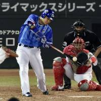 Yokohama's Yoshitomo Tsutsugo hits a two-run home run in the fifth inning of the BayStars' 9-3 win over the Carp on Tuesday in Game 5 of the Central League Climax Series Final Stage. | KYODO