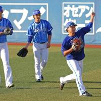 BayStars pitchers take part in a practice at Yokohama Stadium on Monday ahead of Tuesday's Game 3 of the Japan Series. | KYODO