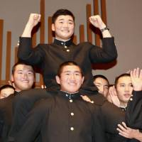 Kotaro Kiyomiya celebrates at Waseda Jitsugyo High School after he was drafted by the Fighters on Thursday. | KAZ NAGATSUKA