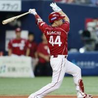The Eagles' Yuichi Adachi whacks a two-run triple in the sixth inning against the Buffaloes on Saturday at Kyocera Dome. Tohoku Rakuten routed Orix 7-0. | KYODO