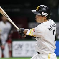 The Hawks' Akira Nakamura slugs a two-run home run in the eighth inning against the Eagles in Game 3 of the Pacific League Climax Series Final Stage on Friday at Yafuoku Dome. Fukuoka SoftBank beat Tohoku Rakuten 7-5. | KYODO