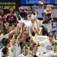 Hawks manager Kimiyasu Kudo is given a doage (victory toss) after the Hawks clinched he PL Climax Series title with a 7-0 win over Rakuten on Sunday in Fukuoka. | KYODO