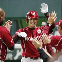 Rakuten's Eigoro Mogi returns to the dugout after hitting a leadoff home run against SoftBank in Game 1 of the Pacific League Climax Series Final Stage on Wednesday in Fukuoka. The Eagles won 3-2. | KYODO
