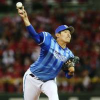 The BayStars' Shoichi Ino tossed 5-1/3 scoreless innings against the Carp on Friday night in the Central League Climax Series Final Stage at Mazda Stadium. Yokohama won 1-0. | KYODO