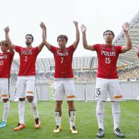 Reds players celebrate after their win over Vegalta on Sunday in Sendai. | KYODO