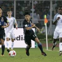 Japan's Taisei Miyashiro (11) chases the ball during Tuesday's Under-17 World Cup game against England in Kolkata. | AP