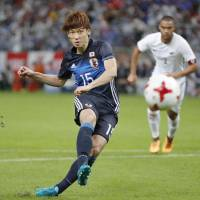Japan's Yuya Osako scores on a penalty kick in the 50th minute against New Zealand on Friday. | KYODO