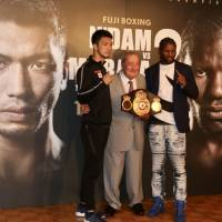 Ryota Murata and Hassan N'Dam (right) pose with legendary promoter Bob Arum on Friday ahead of Sunday's WBA middleweight title rematch at Ryogoku Kokugikan. | KAZ NAGATSUKA