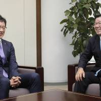 Fighters manager Hideki Kuriyama (left) meets with team owner Juichi Suezawa on Wednesday. | KYODO
