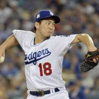 Maeda earns win in relief as Dodgers take NLCS opener