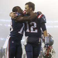 Patriots quarterback Tom Brady (right) hugs receiver Matthew Slater after their 23-7 victory over the Falcons in Foxborough, Massachusetts on Sunday. | USA TODAY / VIA REUTERS