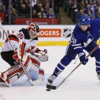 Toronto's Connor Brown tries to get a shot off against New Jersey goalie Cory Schneider in first period on Wednesday night. | USA TODAY / VIA REUTERS