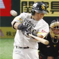 SoftBank's Akira Nakamura connects for a home run against Rakuten in the sixth inning of Game 4 of the PL Climax Series Final Stage on Saturday. | KYODO