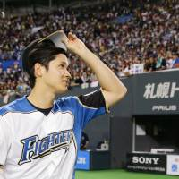 Shohei Otani acknowledges the crowd after throwing a shutout in the Fighters' final home game of the season on Wednesday at Sapporo Dome. | KYODO
