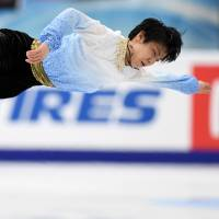 Yuzuru Hanyu competes in the short program at the Cup of Russia in Moscow on Friday night. Hanyu was in second place going into Saturday's free skate. | AFP-JIJI