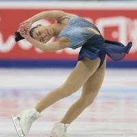 Kaori Sakamoto competes in the short program at the Cup of Russia in Moscow on Friday night. Sakamoto is in fourth place going into Saturday's free skate. | AP