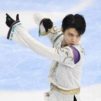 Yuzuru Hanyu skates his free program at the Cup of Russia on Saturday in Moscow. Hanyu finished second overall in the two-day program with 290.77 points. | KYODO