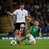 Germany's Julian Draxler is tackled by Northern Ireland's Corry Evans during their World Cup qualifier at Windsor Park in Belfast on Thursday night. | REUTERS