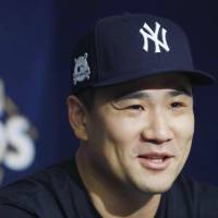 Yankees pitcher Masahiro Tanaka speaks during a news conference on Saturday in Cleveland. | KYODO